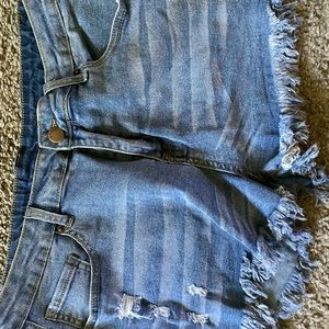 Super distressed jean shorts
